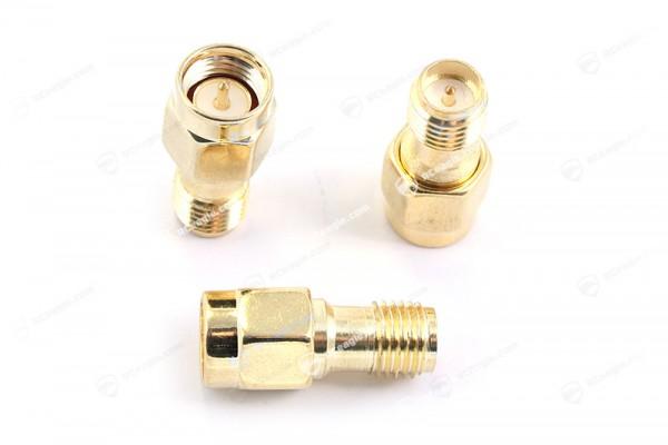 SMA Stecker / RP-SMA Buchse - Adapter Gold für Antennen